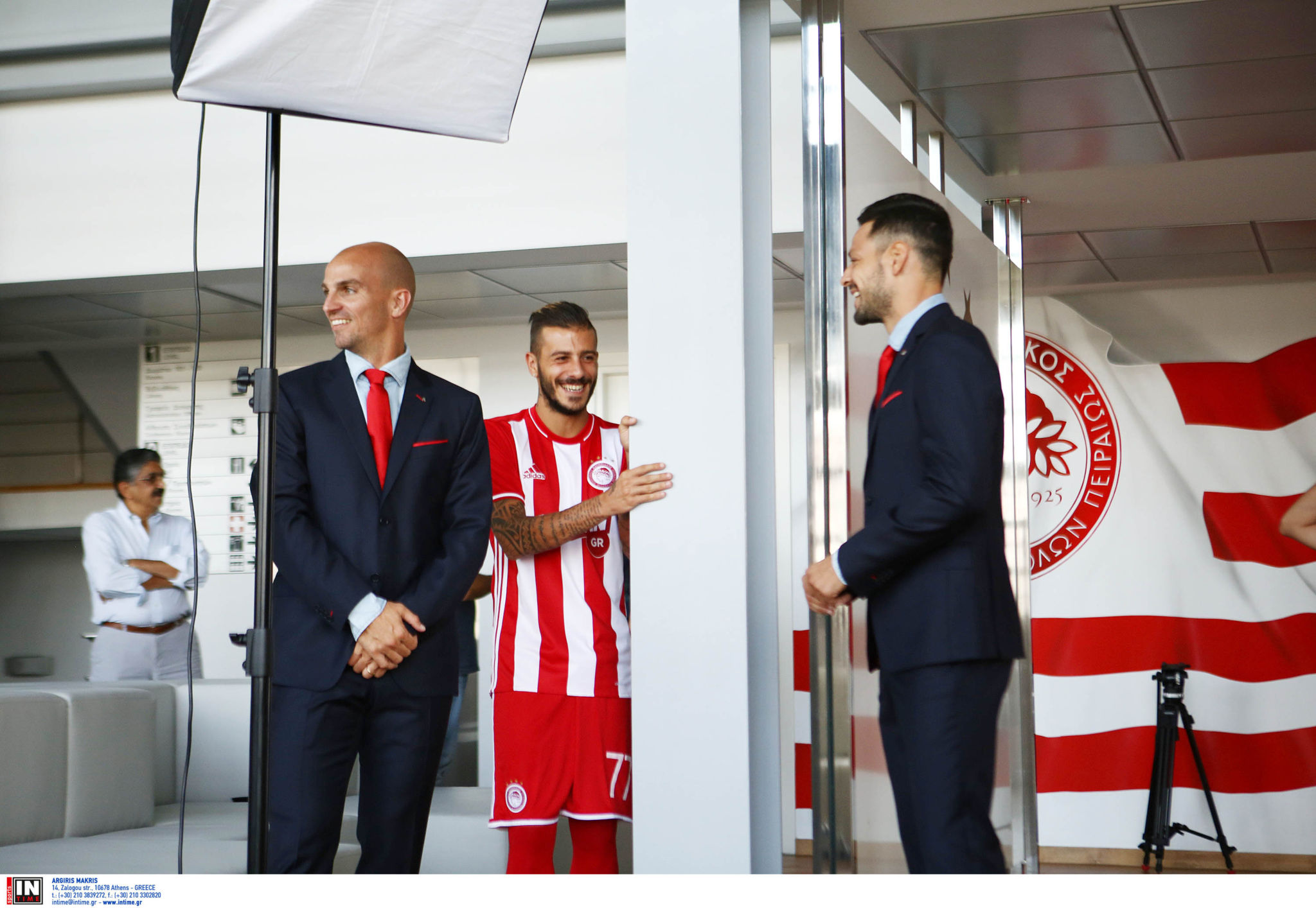 OLYMPIACOS FC players get dressed and photographed in their REPLAY suits